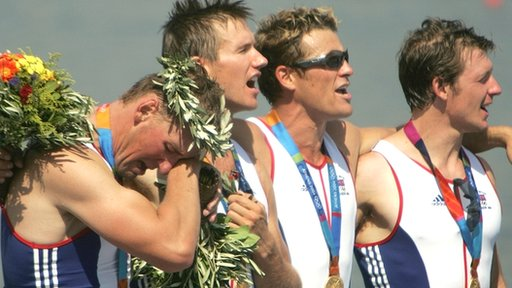 Matthew Pinsent, Ed Coode, James Cracknell and Steve Williams on the podium at the 2004 Olympics
